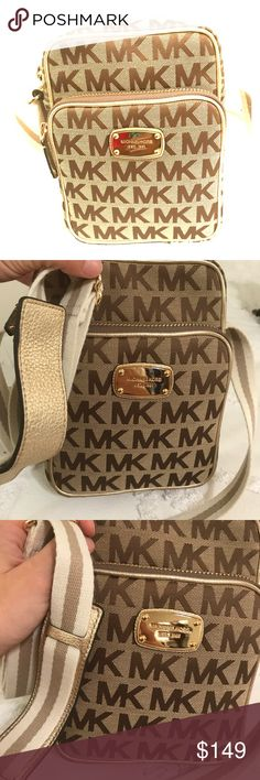 Michael Kors Signature with Webbing Flight Bag Michael Kors Signature with Webbing Flight Bag in beige, ebony, and gold. NWT. This is a gorgeous, yet adorable cross body bag. It features 2 zippered compartments with a flap pocket in the larger compartment https://tmblr.co/ZnVlHd2OD7jzL