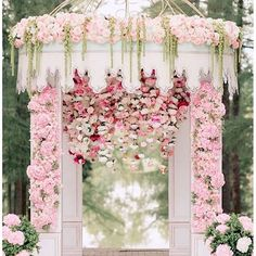 Wedding ceremony decor. I like the flowers inside the sides of the columns