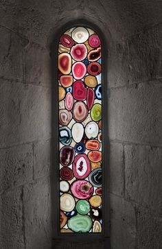 PIN 9 - This is beautiful glass arched fixed window. It's unique as it has the same idea as a stained glass however these looks like thin slices of quart crystal naturally found in rock formations. Adds a beautiful coloured light to the room.