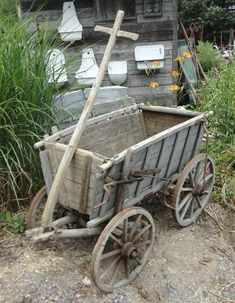 common ground : Spring Paint Refresh for the Goat Cart Wooden Cart, Wooden Wagon, Popsicle Stick Crafts, Craft Stick Crafts, Small Black Table, Hand Cart, Old Wagons, Spring Painting, Wagon Wheel