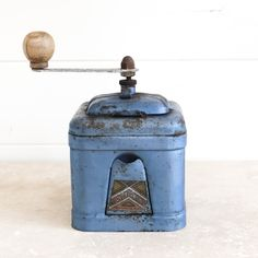 """Blue French Vintage Coffee Grinder made by the Peugeot brothers in the 1930s. This is a lovely French coffee grinder """"moulin a cafe"""" made of wood."""