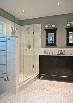 White/Cream/NeutralSubway Tile-shower & floor. Teal/blue paint. Black Vanity & Mirrors. If I codbt do brown bathroom I wold like this.