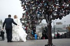 Love padlock tree in Moscow Russia!! Go with your husband with a lock and put it on one of these trees. Lock it and throw away the key representing your love that will last forever! Neat idea!