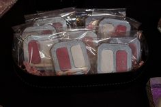 """Glam party favors.  Chocolate eyeshadow palette sprayed with silver edible spray.  """"Eyeshadows"""" are mad with pink and pearl luster icing sheets from Edible Images. Fondant applicator"""