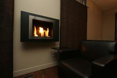 One of our most popular wall mounted ethanol fireplaces. Lifted to TV height to heat up any room!