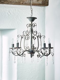 Add a touch of elegance to your bedroom with our beautiful vintage finished grey chandelier. Made from lightweight metal with a distressed painted finish, clear bead drop details and 5 stems for bulbs, our Florence Chandelier complements our vintage inspired velvet quilts.   Click here to view our useful lighting buying guide, and take a look at our blog for ideas on how incorporate lighting into your home.
