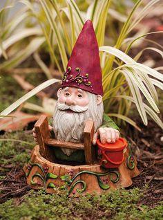 Gnome in a hole.... I like him!