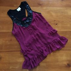 Anthropologie Luluvia by Lulumari Blouse Red wine colored polyester top, black trim and black leather decoration along neck, razorback, ruffles along lower edges, excellent condition Anthropologie Tops Blouses