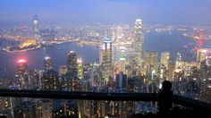 A view of Hong Kong Island, Hong Kong Harbor and Kowloon from The Peak at sunset.
