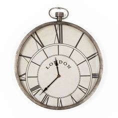 Tell the time in style with this quirky metal clock from the Graham & Brown wall art collection. This giant metal pocket watch clock is perfect to add a vintage feel to your home. Designed in striking black and white this piece is the perfect statement time piece.  Measures 42.5cm x 50.5 cm