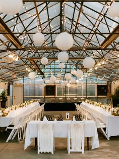 Modern + industrial green house wedding reception: http://www.stylemepretty.com/michigan-weddings/2016/01/04/elegant-industrial-green-house-wedding/ | Photography: Santiago Murillo - http://www.santimurillo.com/