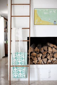 """Hanging Blanket StorageUsing a leaning ladder for vertical blanket storage is a look I've always thought of as """"traditional country,"""" but lately I've seen this functional decor idea in more contemporary homes. You can make this look more modern by using a sleek ladder or minimal blankets with graphic patterns.Next: DIY Wooden Coffee Table #refinery29 http://www.refinery29.com/a-beautiful-mess/14#slide-5"""