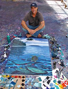 Wyland... saw him all over HI. I've loved his work ever since I saw his large murals as a kid in Key West.