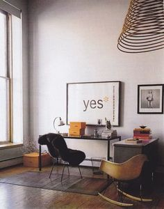 giant framed poster and cool rocking chair / via mechantdesign