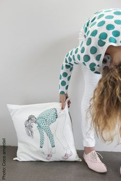 Draw a simple picture on a pillow or comforter that represents you!!