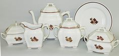 """1890; all with black ink mark """"Warranted/ Ironstone China/ Trade Mark/ John Edwards/ England"""": a plate, covered teapot impressed """"Peerless"""", covered sugar bowl, creamer impressed """"Peerless"""" and a pair of covered butter tubs with insert perforated liners impressed """"Peerless"""";"""
