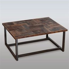 The reclaimed wood coffee table is fabricated in Georgia. The hand welded steel base is buffed to an antique bronze patina for a rustic yet contemporary feel. - Made in USA - Measures approximately 32