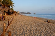 7. Zipolite. This beach was known as a free love center from the 60's to the 80's, and a huge counterculture destination. It gained notoriety as one of Mexico's few nude beaches, although the majority of sunbathers remain clothed. Today, it attracts an international class of sun lovers, shirtless yoga gurus and surfers. While there are still plenty of budget lodgings, a number of midrange hotels and classier restaurants have appeared at the west end of the village. Touropia