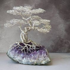 A non tarnishing silver plated copper wire bonsai tree on an amethyst base