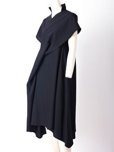 Yohji Yamamoto, wool dress with asymmetric hem and front draped bias panel from shoulder to the hem. Stand collar, short kimono sleeves.view 2