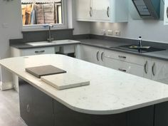 This is a fantastic combination of two quartz colours, the Carrera used on the island and the Grigio Scuro Stella used on the L'shape worktop area. Plus we fitted matching grey upstands and windowsill. Small Kitchen Renovations, Kitchen Remodel, Chris Kitchen, Marble Quartz, Diy Kitchen, Kitchen Ideas, Kitchen Tables, Granite Colors, Kitchen Worktop