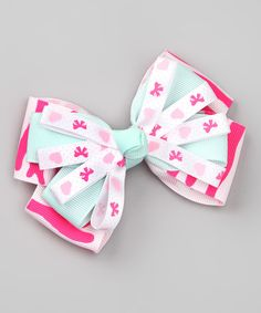 Adding a fun finishing touch to any outfit is easy with this beautiful bowtie hair clip. Handmade from quality grosgrain ribbon that's been sealed to prevent fraying, it makes the perfect unique gift for any special sweetie.4'' W x 2'' HGrosgrain ribbonSpot cleanImported