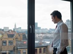 Stock Photo : Businessman looking at urban landscape