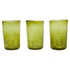 Crafted by hand, this stunning glass tumbler features a classic design and coloured finish that may vary slightly between products. Perfect for serving individual desserts at dinner parties or drinks in the garden.  Product: Set of 3 tumblersConstruction Material: GlassColour: Olive greenDimensions: 10 cm H x 6 cm Diameter eachNote: Due to the handmade nature of this product please expect slight variations in colours