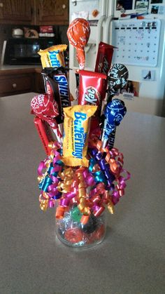 Candy mason jar bouquet!! Perfect for birthday presents!!