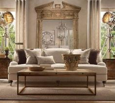 I love colour but I really love these neutral tones too. great pillows and coffee table