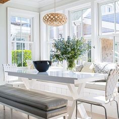 Happy Sunday! Breezy rows of French doors open off this #Nantucket living and dining rooms, while the #kitchen terminates in an eat-in bay where sunlight streams in through double-hung windows. Design by @cynthiahayes_id; Styling by @eleanor_roper; : @johneeebee. #breakfastroom #interiordesign
