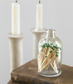 Think Outside the Box    Who wants to display an unsightly carton of safety matches? Instead, pair your candles with this objet d'art: a reclaimed apothecary jar, with a hand-etched bottom for striking. ($20; raredevice.net)