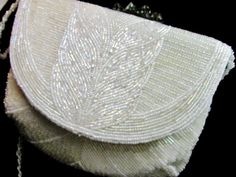 Hey, I found this really awesome Etsy listing at https://www.etsy.com/listing/213461922/vintage-clutch-white-iridescent-bead