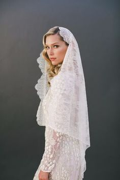 6. Cathedral length never looked so good! This veil with chantilly lace from VeiledBeauty is on point and stunning in every way.Shop Now: VeiledBeauty