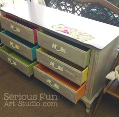 Serious Fun Art Studio in Florida painted this dresser using Smoke Signal, Momma's Lipstick, A-maize-ing, Orange Grove, Nana's Cupboard, Shoreline and finished the hardware with Pewter Mica and Top Coat.