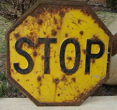 When I was a teenager, we still had a few of these yellow and black stop signs in our small town.