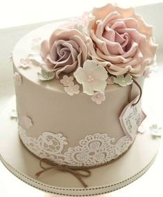 Elegant Brown Birthday Cake Images with Flower Toppers