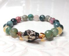 Digging these amazing skull crystal beads… Swarovski Crystal Skull Stretch Bracelet Boho Multi by LoveandLulu