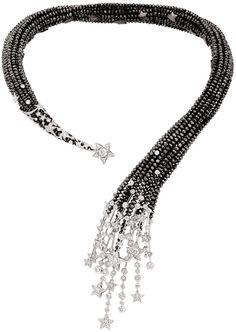 "Chanel ""Nuit de Diamants"" necklace in 18-karat white gold set with 319 brilliant-cut diamonds for a total weight of 11.9 carats 7 round-cut diamonds for a total weight of 2.9 carats and facetted black-diamond beads for a total weight of 453.3 carats.     Via The Jewellery Editor."