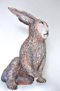"""Concerns of Rabbit"" by Elizabeth Ostrander, Ceramic and Acrylic, 21"" x 11"" x 18"". Available at www.maine-art.com"