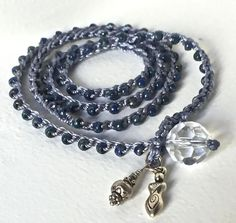 Crochet wrap bracelet -or- long boho necklace. Beautiful blue and silver Picasso seed beads -are crocheted on sturdy blue nylon cord. Two charms, a Goddess charm and a sterling bead, hang from the crystal and loop closure. Ball and socket closure. Measures 25 1/2. Will wrap 4 times around a 6-6 1/2 wrist. Can also be worn as a necklace. To see my other crocheted bracelets click here: https://www.etsy.com/shop/JanesAddiction/edit?ref=hdr_shop_menu&...