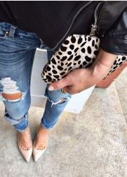 Easy style formula: leopard clutch and ripped denim.