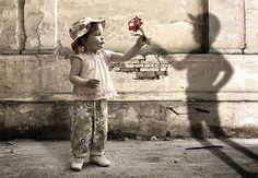 Forced Perspective Photography (girl giving flower to shadow boy)