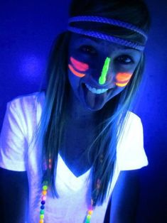 glow in the dark face paint.  It would be awesome to use glow sticks as headbands.