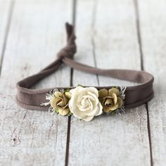 This listing is for a Brown Flower Jersey Tieback Headband.  Jersey headband is ONE SIZE FITS ALL  PLEASE READ SHOP POLICIES BEFORE MAKING A PURCHASE.