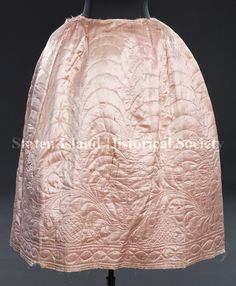 Petticoat  Date	1750-1790 American.  Description	Woman's quilted petticoat. Handsewn, pink silk satin with linen lining. Pleated at waist. Right side opening with satin ties. This type of petticoat was a visible part of women's dress.  (Staten Island Historical Society Collection)
