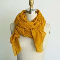 Long and skinny in rust or mustard, please! UNIFORM natural | gold curry gossamer scarf. http://scarfshop.bigcartel.com/