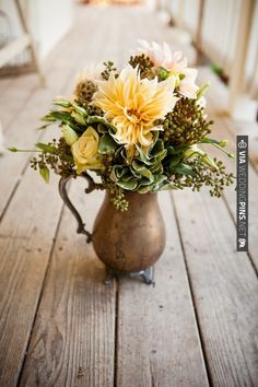 floral arrangement in rustic vintage vase | CHECK OUT MORE IDEAS AT WEDDINGPINS.NET | #weddings #weddingflowers #flowers