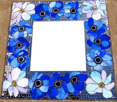 Anemone art glass & mirror mosaic on square mirror. R1,500.00   SOLD