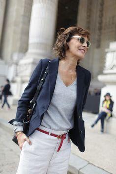 Ines de la Fressange in a navy blazer + grey sweater + white trousers + black tote